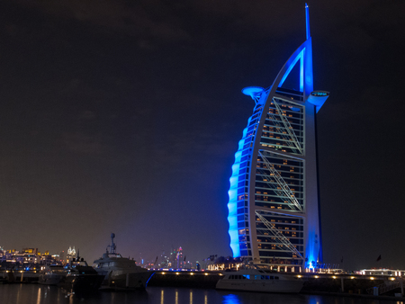 Dubai, UAE - March, 03, 2017: View of the luxury Burj Al Arab, the most exclusive hotel of the world, with seven stars at night.