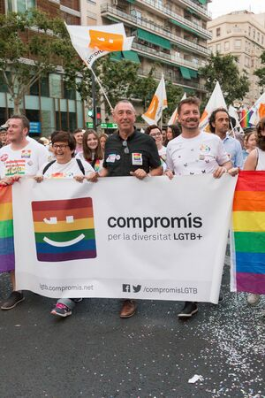 Valencia, Spain - June 16, 2018: Joan Valdov? and part of his political group (Compromis) with a banner on Gay Pride Day in Valencia Editorial