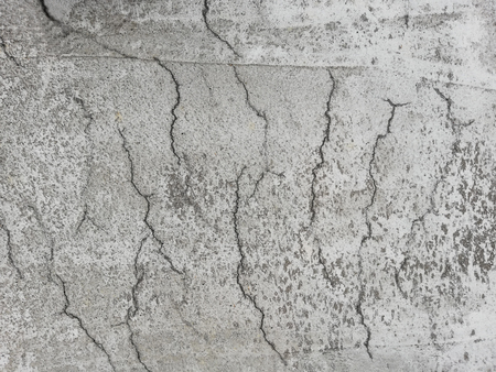 Cracked reinforced concrete on a surface due to shrinkage in the curing process.