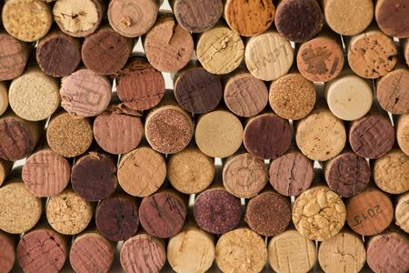 Close-up of used wine cork stoppers forming a pattern creating an original background. 스톡 콘텐츠