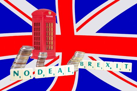 UK No Deal Brexit. The words spelled out and an English telephone booth with an English flag in background. Brexit concept