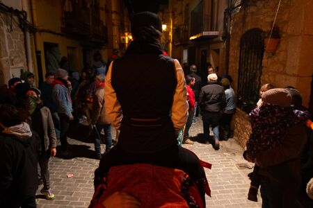 Vilanova d'Alcolea, Castellón, Spain - January 19, 2019: Image behind a horsewoman on a adorned horse in the middle of the street in a traditional festivals in Castellon, Spain