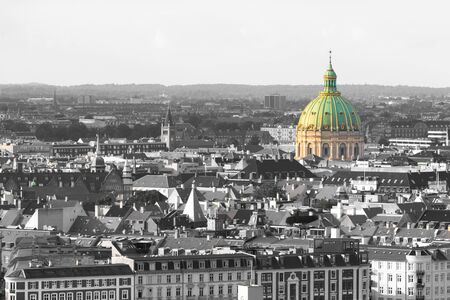 Aerial view of Copenhagen cityscape in black and white with the dome of the Frederik's Church (Frederiks Kirke), also known as the Marble Church in color. Selective color effect