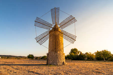 Old restored stone windmill in countryside in Majorca island, Spain. Historic buildings