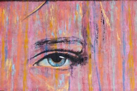 Fanzara (Castellón), Spain - September 20, 2020: Graffiti of a woman's eye created by Carlos Callizo, in the small town in Castellón (Spain) with more than 180 graffiti in its streets creating MIAU (Unfinished Museum of Urban Art) in Fanzara . Art conce