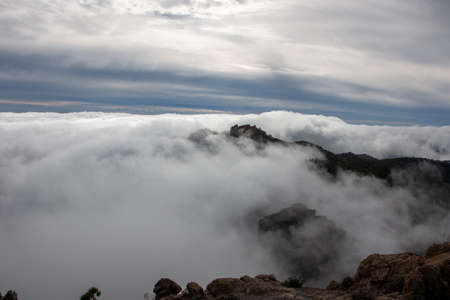 Sea of clouds above the summit of the island of Gran Canaria. Weather concept