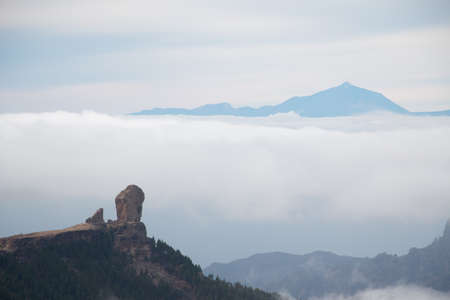 Scenic view of Roque Nublo and El Teide between sea of clouds from Gran Canaria, Canary Islands, Spain. Nature concept
