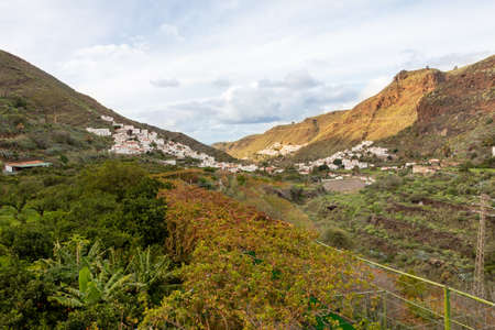 Small town on the slopes of the Agaete valley on the island of Gran Canaria. Travel concept