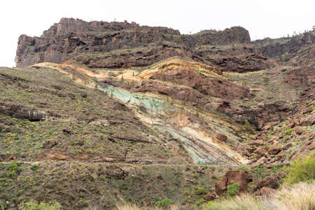 Bluish strata on the inner face of a crater produced by the alteration of minerals by the lava from the volcano. They are known as