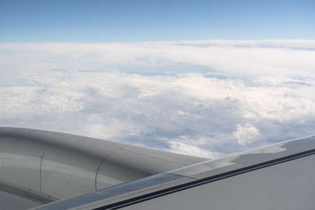 View of a Wing and turbine of an airplane flying above the clouds. Copyspace concept Standard-Bild