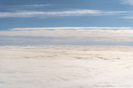 Aerial view of a blue sky background over sea of clouds. Travel concept