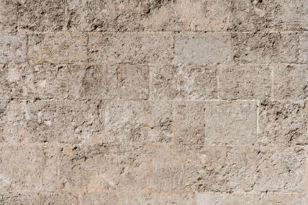 Background texture of a stone wall brown tones