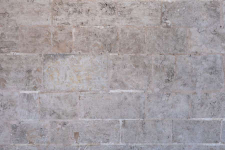 Texture of an old stone wall in brown tones. Architecture backgrounds