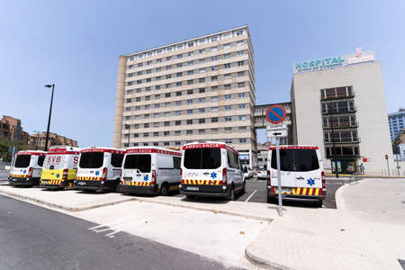 Valencia, Spain -July 24, 2021: Main facade with ambulance parking in the foreground of the