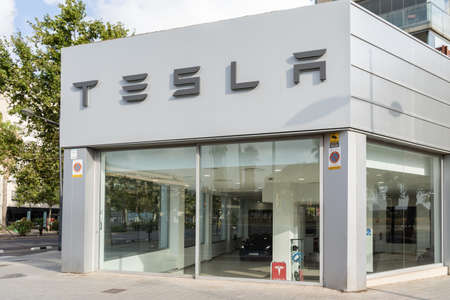 Valencia, Spain - July 24, 2021: Tesla store. Tesla is a specialized American company in electric cars, energy storage and solar panel manufacturing