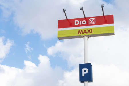 Valencia, Spain - July 24, 2021: Billboard on the top of a pole of DIA MAXI supermarkets implanted in Spain, Portugal, Argentina and Brazil, which is listed on the Stock Exchange