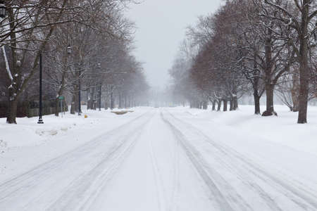 Car driving on a snowy road in Southern Ontario, Canada. Stock Photo