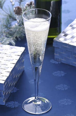 Champagne flute with recently poured sparkling wine.