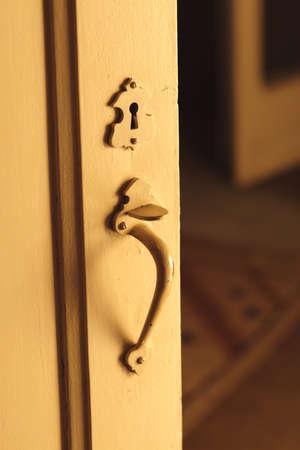 Antique door with oldf fashioned handle left ajar