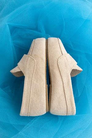 Boys light brown nubuck shoes on blue background