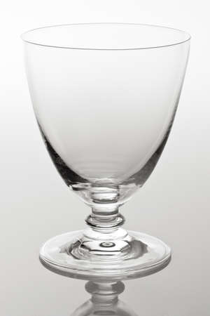 Empty cocktail glass on white background