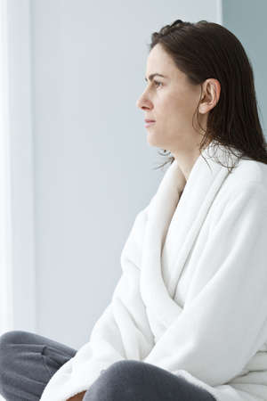Profile of a woman sitting cross-legged