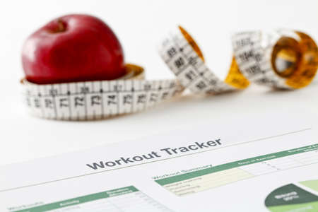 Spreadsheet printout, red apple and measuring tape Stock Photo - 9533684
