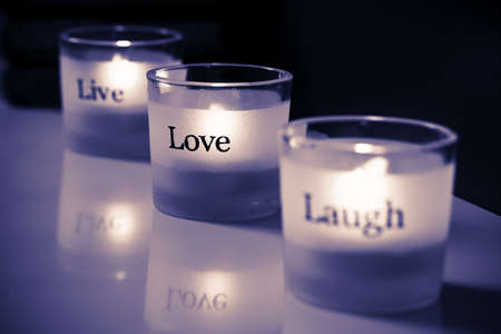 Live-Love-Laugh tea lights. Stock Photo