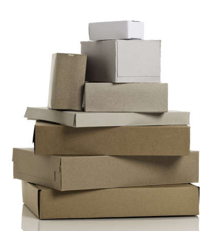 Various cardboard boxes stacked up, isolated on white background.