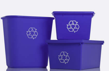 Three blue recycling bins isolated on white background.  Stock Photo