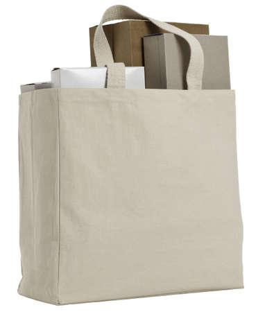 Reusable shopping bag with various plain cardbard boxes.