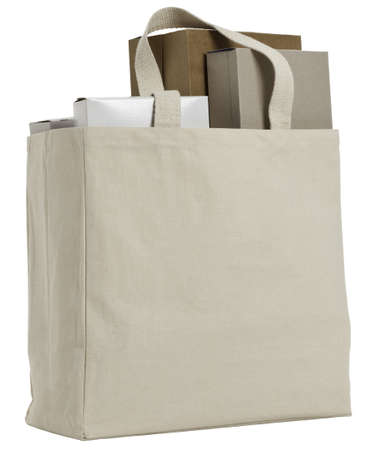 Reusable shopping bag with various plain cardbard boxes.