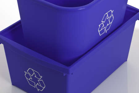 Close-up of two blue bins.