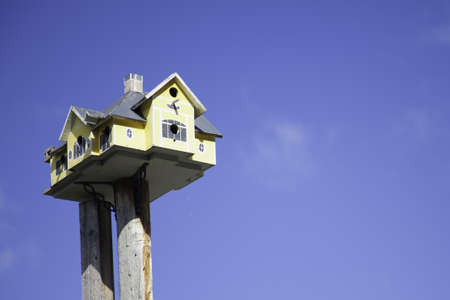 Yellow Birdhouse Stock Photo