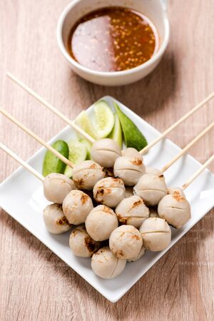 cooked pepper ball: meat ball in plate on wood table