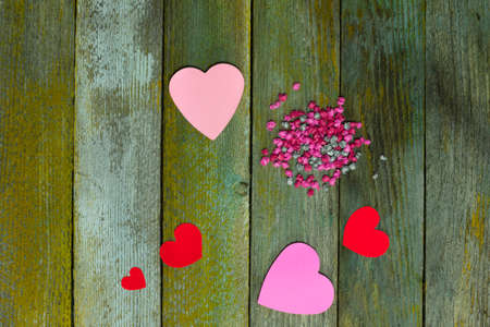 Red hearts on the boards of the fence photo