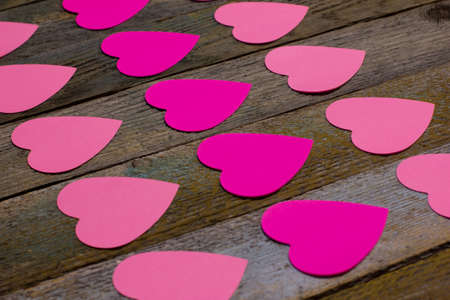 the colorful paper hearts on wooden table photo
