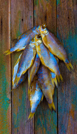 The dried fish on a wooden table photo