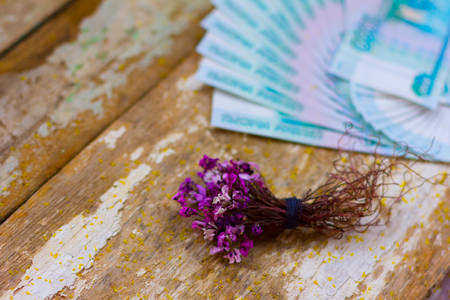 bouquet of flowers wrapped in a dollar bill photo