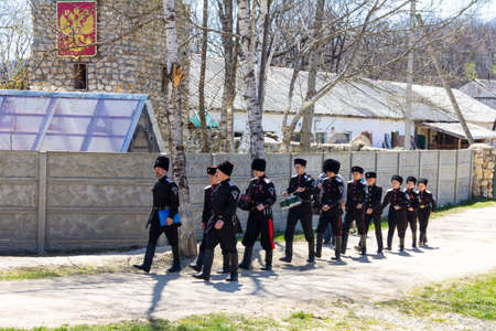 squad: A squad of young Cossacks walking down the street