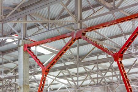metal frame of the roof of industrial premises in the enterprise inside view 写真素材
