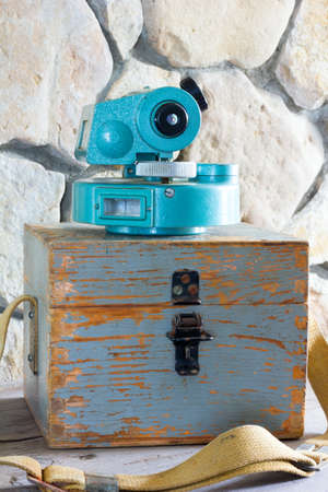 measuring instrument: old measuring instrument theodolite on a wooden box close up Stock Photo