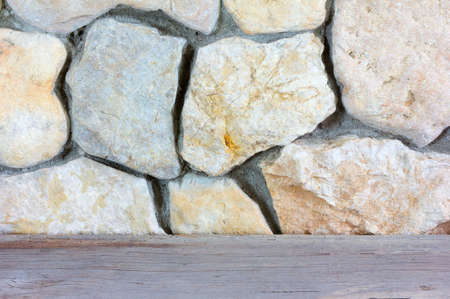 countertop: old grey wooden countertop near the wall of stone limestone Stock Photo