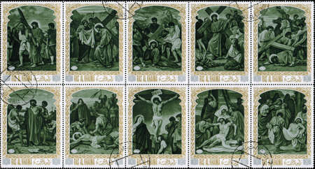 interlock: Ras al Khaimah - CIRCA 1972: mail stamp printed in Ras al Khaimah the court, carrying the cross, crucifixion, descent from the cross and burial of Jesus Christ. Christian themes
