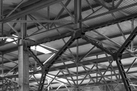 roof framework: metal framework of the roof of industrial premises in the enterprise inside view in black and white Stock Photo