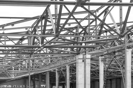 production facility: roof frame from metal parts on the newly built production facility, in black and white photo