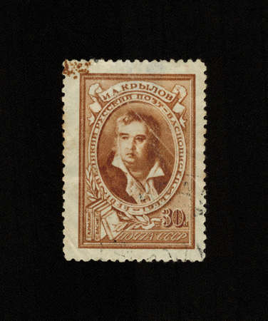 the publisher: USSR - CIRCA 1944: A stamp printed in USSR shows Ivan Krylov, Russian journalist, poet, fabulist, publisher satirical-educational magazines. Best known as the author 236 fables, collected in nine lifetime collections, circa 1944 Editorial
