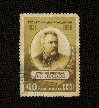 publicist: USSR - CIRCA 1956: A stamp printed in USSR shows Nikolai Leskov Russian publicist, writer