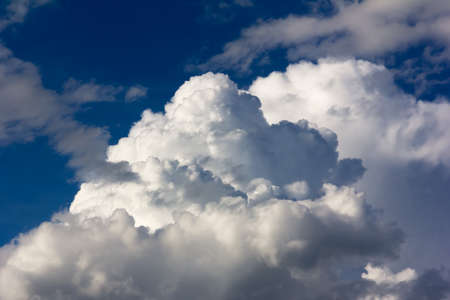 cumulus: Large cumulus clouds against a bright blue sky closeup Stock Photo