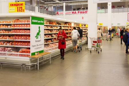 visitors: Krasnodar, RUSSIA - OCTOBER 13 2015: Visitors make purchases in the supermarket Auchan in Krasnodar
